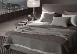 POEMO DESIGN: CAPI UNICI SENZA TEMPO PER VESTIRE LA CAMERA DA LETTO: Camera da letto in stile in stile Eclettico di POEMO DESIGN