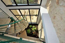 EXTENSION D'UNE MAISON: Jardin d'hiver de style  par JOSE MARCOS ARCHITECTEUR