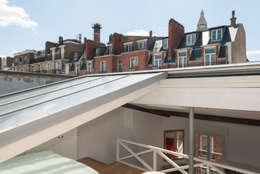 Appartement cabriolet: Terrasse de style  par Emmanuel CROS architecture