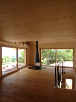 Villa bois - Arzier: Maisons de style de style eclectique par Mueller Concept