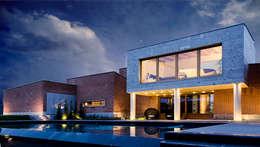 Projekty, nowoczesne Domy zaprojektowane przez Matteo Gattoni - Architetto