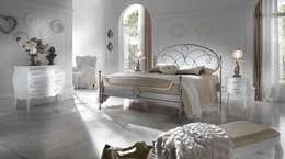 Dormitorios de estilo  por Ferrari Rino e Luigi snc