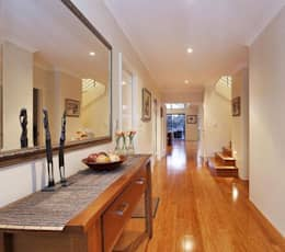 Corridor & hallway by Adorn Interior Design
