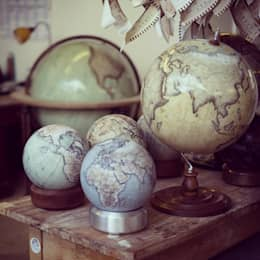 A Luminom base with a Cool Blue Mini Desk Globe:  Household by Bellerby and Co Globemakers