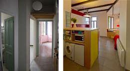 Les pièces de vie avant et après (depuis l'entrée): Salon de style de style Moderne par Atelier RnB