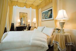 Il Piumino D'OC: Camera da letto in stile in stile Classico di Piumini Danesi