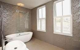 Baños de estilo moderno por Porcel-Thin