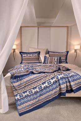 Camera da letto in stile in stile Scandinavo di FEILER