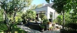 Extension d'une maison à Plescop: Maisons de style de style Moderne par BERNIER ARCHITECTE