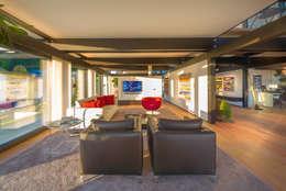 modern Living room by HUF HAUS GmbH u. Co. KG