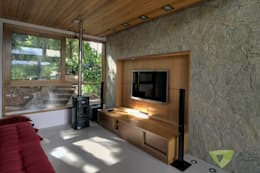 Salas multimedia de estilo rústico por Olaa Arquitetos