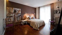 Appartamento ad Ostiense - Roma: Camera da letto in stile in stile Moderno di Archifacturing