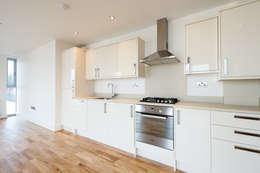 Cozinhas minimalistas por Granit Architects