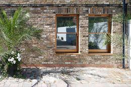 Khu Thương mại by Granit Architects