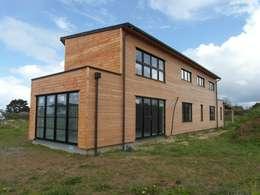 Quelques réalisations  de maisons bioclimatiques dessinées ces dernières années: Maisons de style de style Moderne par GUENNOC Soizic
