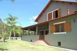 Casas de estilo  por arquiteto
