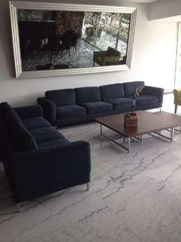 Salas minimalistas 10 sillones espectaculares for Sala gris con azul