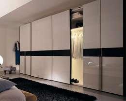 Dormitorios de estilo escandinavo por MUEBLES RABANAL SL