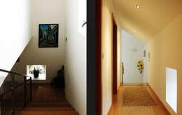 Pasillos y recibidores de estilo  por EVA | evolutionary architecture