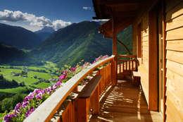 Casas de estilo rústico por Thoma Holz GmbH