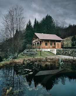 Casas de estilo rural por Thoma Holz GmbH