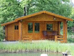 Casas de estilo escandinavo por Betana Blockhaus GmbH