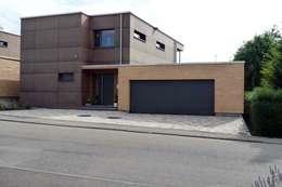 Garajes de estilo moderno por Architekturbüro Arndt