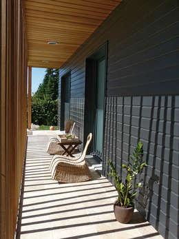 Maison Le K / Vandel - 44: Maisons de style de style Moderne par Gilles Cornevin SARL