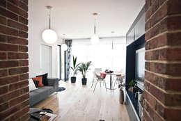 """Mieszkanie """"D"""": styl , w kategorii Salon zaprojektowany przez PRACOWNIA PROJEKTOWA JAGANNA"""