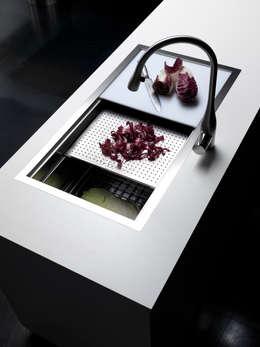 Segno per Effeti: Cucina in stile in stile Minimalista di Vegni Design