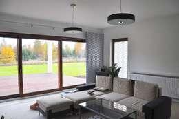 Dom Jednorodzinny PW wnętrza : styl , w kategorii Salon zaprojektowany przez Innebo