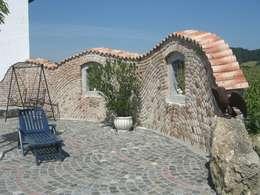 Jardines de estilo mediterráneo por Rimini Baustoffe GmbH
