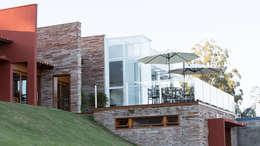 Casas de estilo rústico por Mutabile