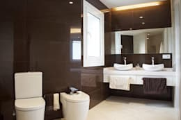 Projekty,  Łazienka zaprojektowane przez Intra Arquitectos