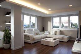 Salas de estar modernas por Intra Arquitectos