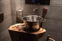 Banheiros rústicos por DF Design