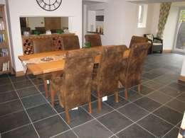 modern Dining room by Floors of Stone Ltd