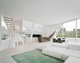 Salas / recibidores de estilo moderno por project a01 architects, ZT Gmbh