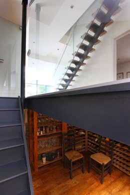 Vestíbulos, pasillos y escaleras de estilo  por PAD ARCHITECTS