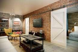 Salas de estilo industrial por CO:interior