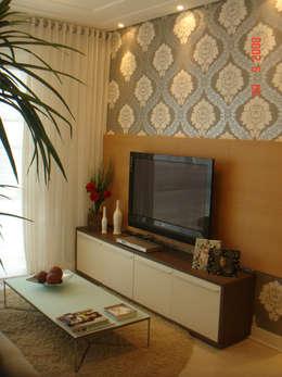 Projeto arquitetonico do apartamento decorado do Green Village Residence: Salas de estar ecléticas por ArchDesign STUDIO