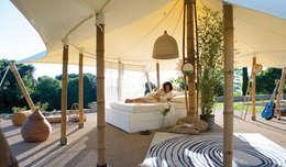 La petite tente bambou : 20m2 de bonheur au coeur de votre jardin !: Hôtels de style  par Marie de Saint Victor