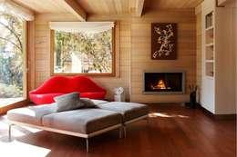 casa in legno: Soggiorno in stile in stile Moderno di alberico & giachetti architetti associati