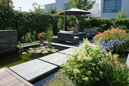 Lush city garden design: moderne Tuin door RAW architectuurstudio