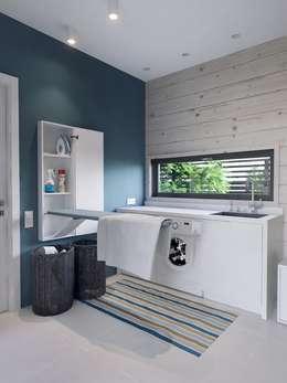 Интерьер дома AUS: Ванные комнаты в . Автор – INT2architecture