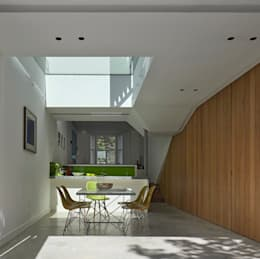 Dining and Kitchen space with folded planes and skylight: modern Dining room by Neil Dusheiko Architects