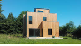 Maison basse consommation à  Fleury la forêt (Eure): Maisons de style de style Moderne par kapok