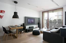 Minimalistyczny Apartament 43m2 Warszawa: styl , w kategorii Salon zaprojektowany przez The Vibe