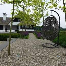 Jardins modernos por Hendriks Hoveniers