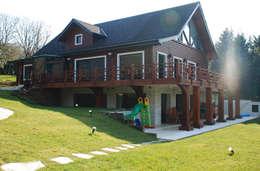 Projekty, wiejskie Domy zaprojektowane przez NM Mimarlık Danışmanlık İnşaat Turizm San. ve Dış Tic. Ltd. Şti.
